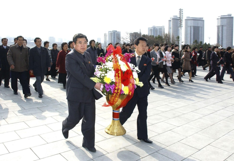 North Koreans offer flowers on the 101st anniversary of Kim Il-sung's birth, at Mansudae in Pyongyang