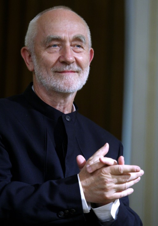 Swiss architect Zumthor applauds during a ceremony honouring him with the Pritzker Architecture Prize in Buenos Aires