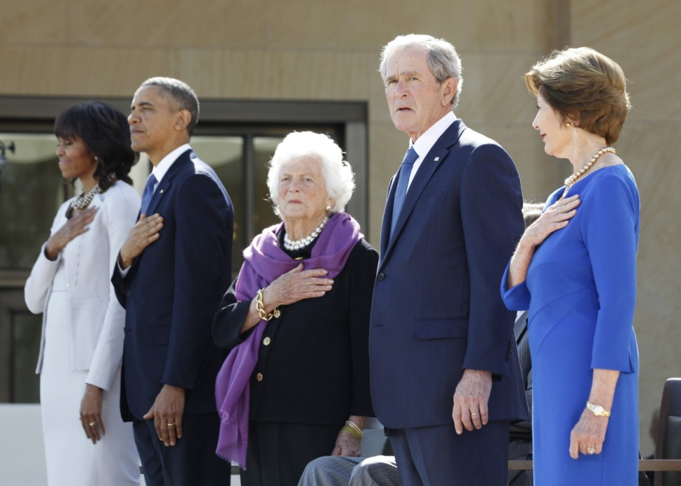 Former U.S. President George W. Bush is pictured on stage alongside his wife, parents and the First Couple as they attend the dedication ceremony for the George W. Bush Presidential Center in Dallas