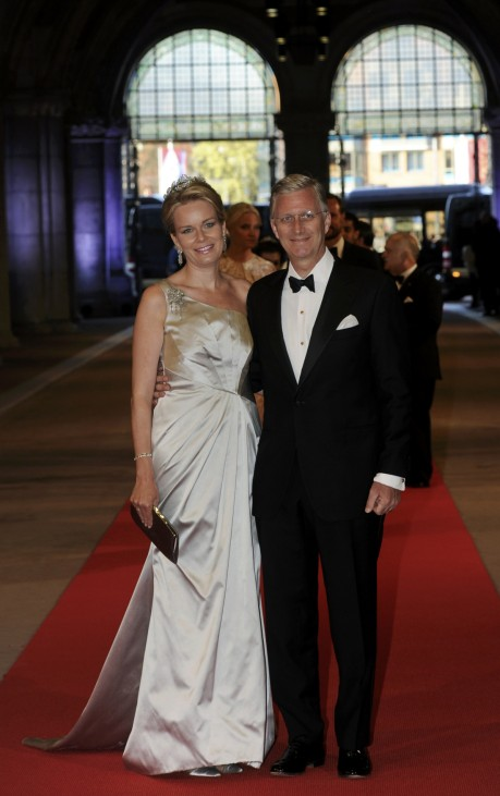 Belgian Crown Prince Philippe and his wife Crown Princess Mathilde arrive at a gala dinner organised on the eve of the abdication of Queen Beatrix of the Netherlands in Amsterdam