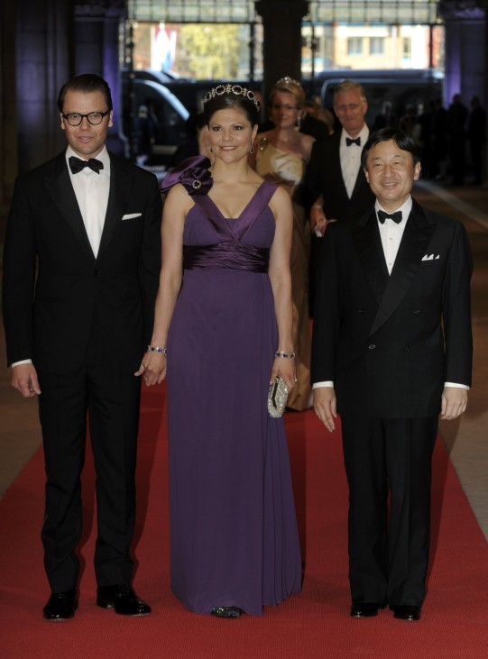 Crown Princess Victoria of Sweden her husband Prince Daniel and Crown Prince Naruhito of Japan arrive at a gala dinner organised on the eve of the abdication of Queen Beatrix of the Netherlands in Amsterdam
