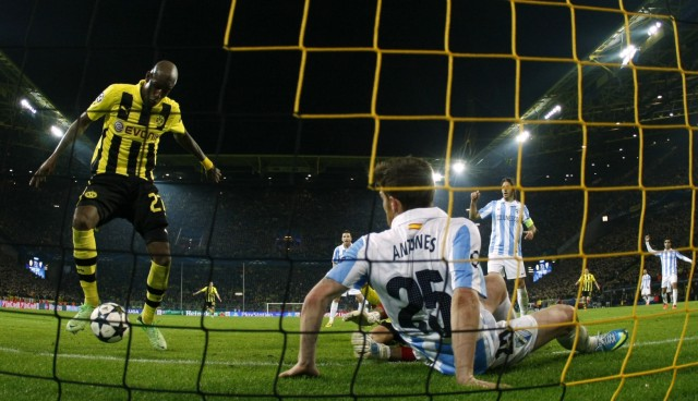 Borussia Dortmund's Santana scores third and winning goal against Malaga during Champions League quarter-final second leg soccer match against Borussia Dortmund in Dortmund