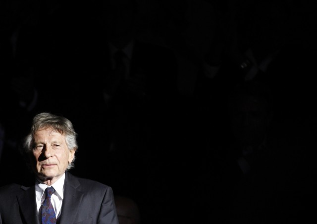 Director Roman Polanski arrives on stage to receive his tribute award at Zurich's Film Festival