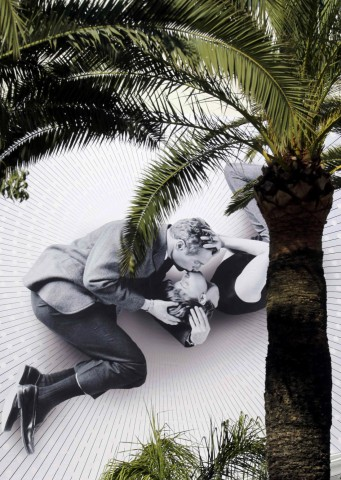 A giant canvas of the official poster of the 66th Cannes Film Festival featuring Joanne Woodward and Paul Newman, photographed during the shooting of 'A New Kind of Love', is seen on the facade of the Festival Palace in Cannes