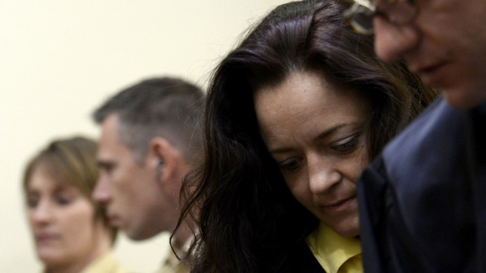 Defendant Zschaepe arrives for the third session of her trial in a courtroom in Munich