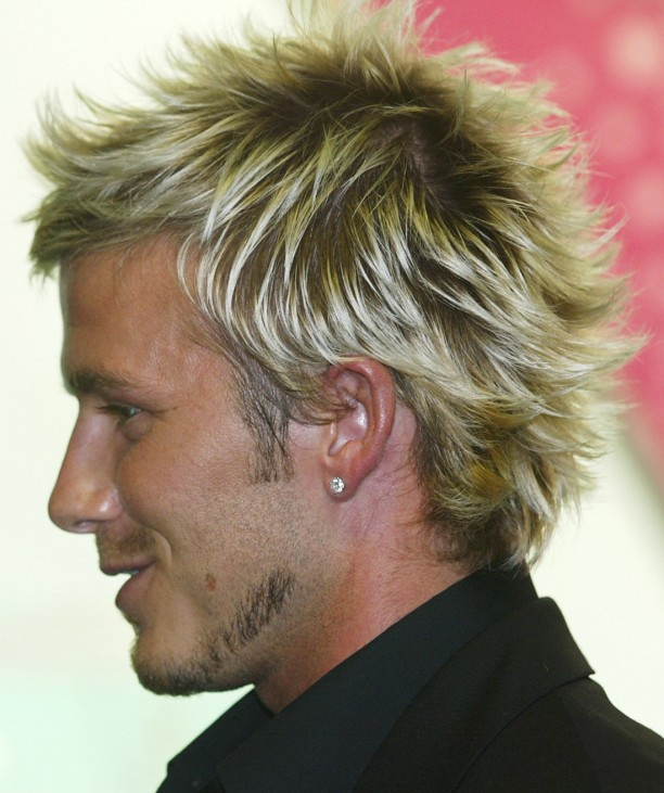 ENGLAND SOCCER STAR DAVID BECKHAM SHOWS OFF NEW HAIR STYLE IN MANCHESTER