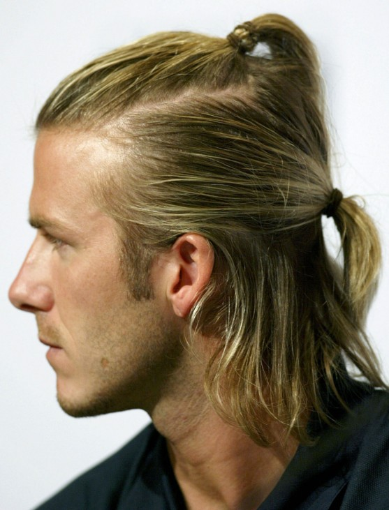REAL MADRID'S BECKHAM LOOKS ON AT NEWS CONFERENCE IN HONG KONG