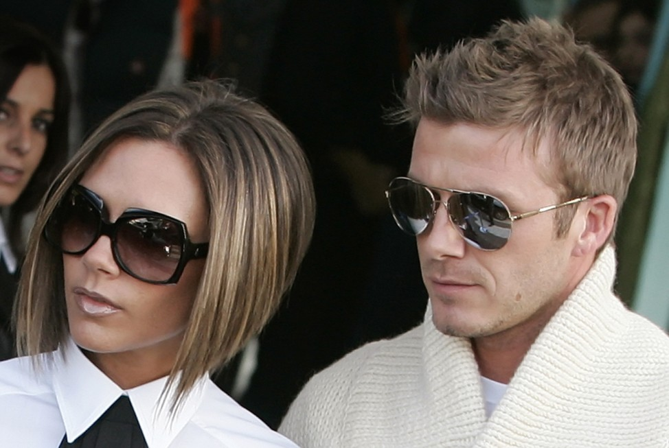 David and Victoria Beckham arrive at the Ciampino airport in Rome