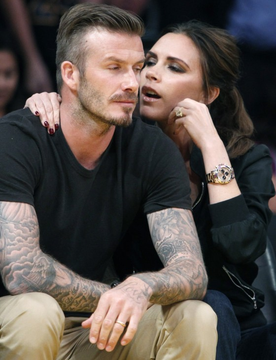 File photo of soccer star David Beckham sitting courtside with his wife Victoria during the Los Angeles Lakers against Denver Nuggets NBA playoff game in Los Angeles