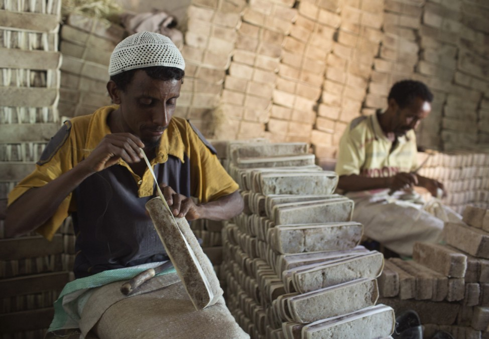 Men prepare bars of salt to be sold in a shop in the main market of the city of Mekele, northern Ethiopia