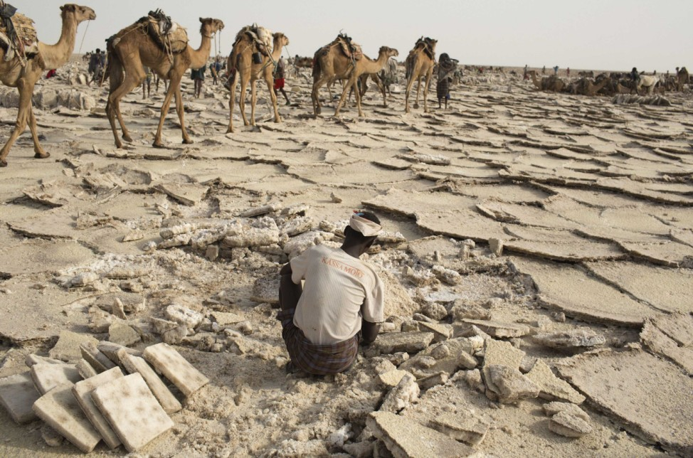 A worker extracts salt from the desert in the Danakil Depression, northern Ethiopia