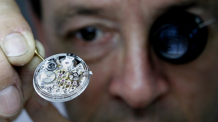 File picture shows watchmaker Lefrancois checking the movement of a  model of Vacheron Constantin watch in Plan-les-Ouates