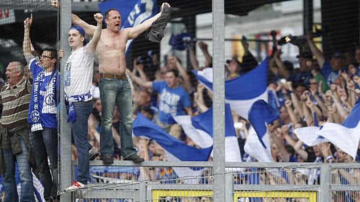 Supporters of Schalke 04 react after winning their German first division Bundesliga soccer match against SC Freiburg in Freiburg