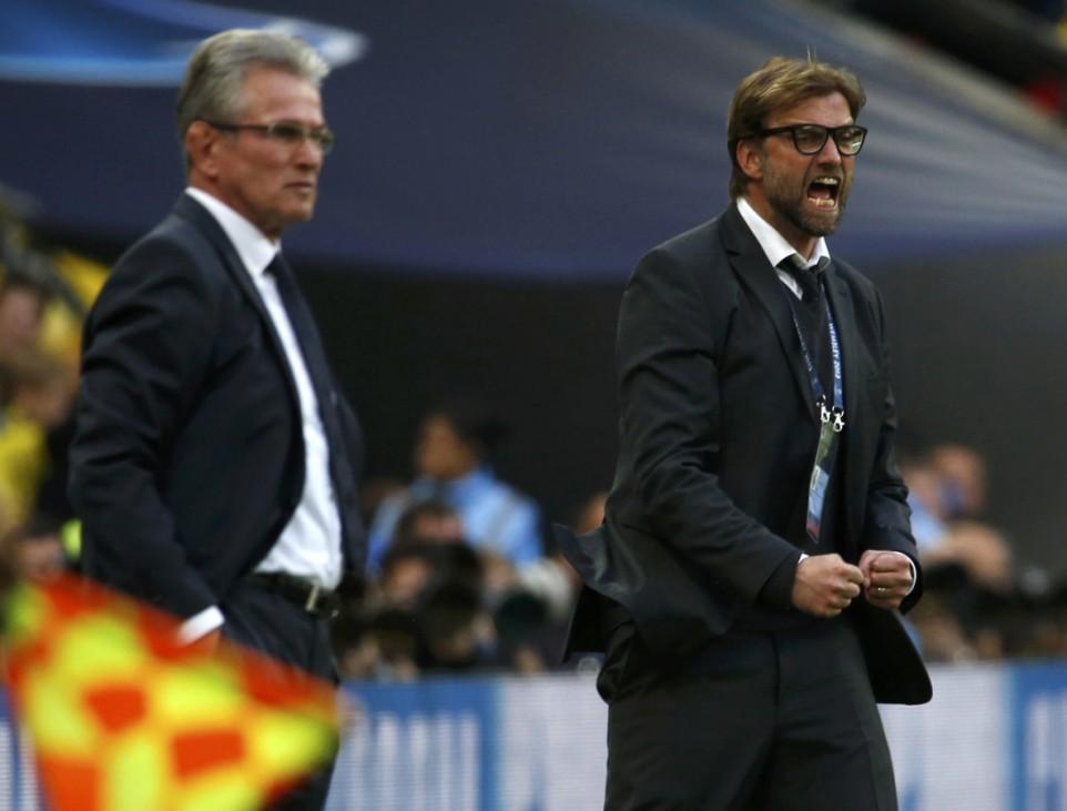 Borussia Dortmund's coach Klopp reacts as Bayern Munich's coach Heynckes looks on during their Champions League Final soccer match at Wembley Stadium in London