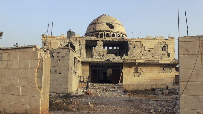 Damaged mosque is seen in Qusair village, where forces of Syrian President Bashar al-Assad and rebel forces have been fighting