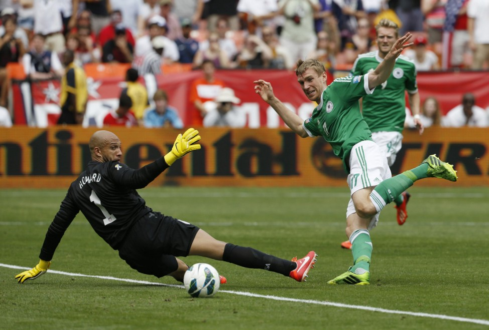 Germany's defender Per Mertesacker makes an unsuccessful attempt at goal past USA goalkeeper Tim Howard in the first half of their soccer match at RFK Stadium in Washington