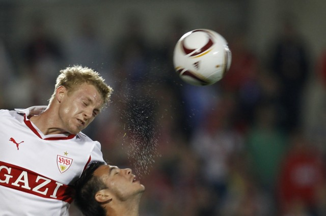 Getafe's Sardinero  fights to head the ball with VfB Stuttgart's Funk during their Europa League Group H soccer match at Colisseum Alfonso Perez stadium in Getafe