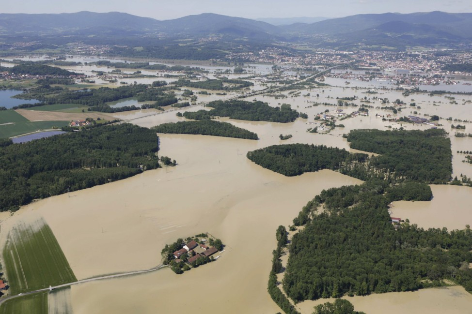 A small settlement is totally surrounded by the floods of the river Danube near the eastern Bavarian city of Deggendorf