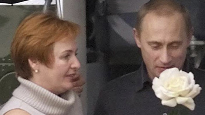 File photo of the wife of Putin presenting a yellow rose in Crawford, Texas