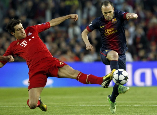 Bayern Munich's Martinez tackles Barcelona's Hernandez during Champions League semi-final second leg soccer match in Barcelona