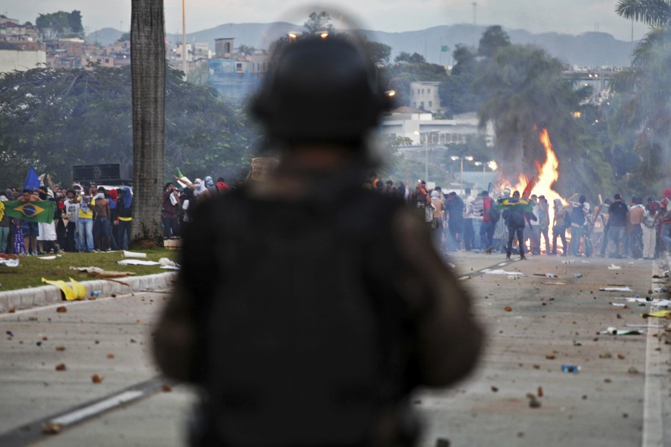Demonstrators face riot police during one of the many protests around Brazil's major cities in Belo Horizonte