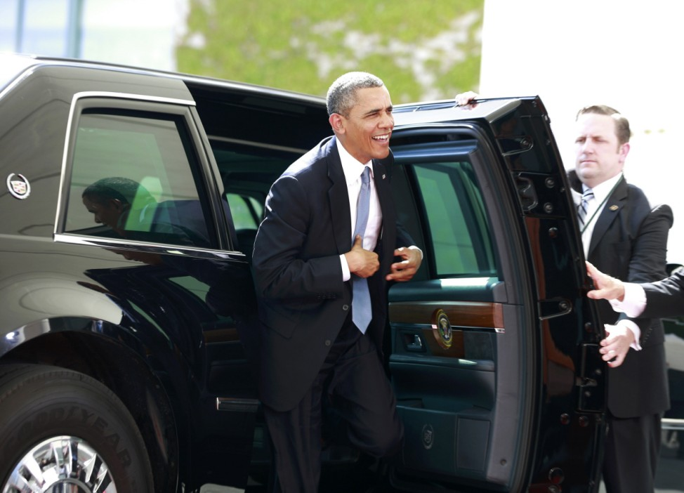 U.S. President Obama leaves the car as he arrives to meet German Chancellor Merkel at the Chancellery in Berlin