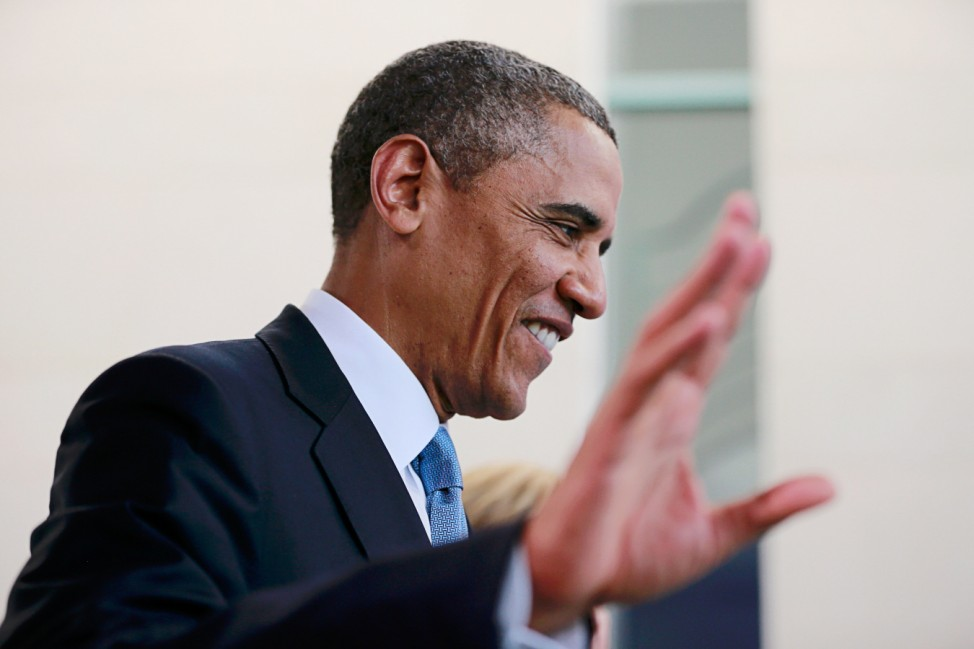 U.S. President Obama gestures during a news conference after his meeting with German Chancellor Merkel at the Chancellery in Berlin