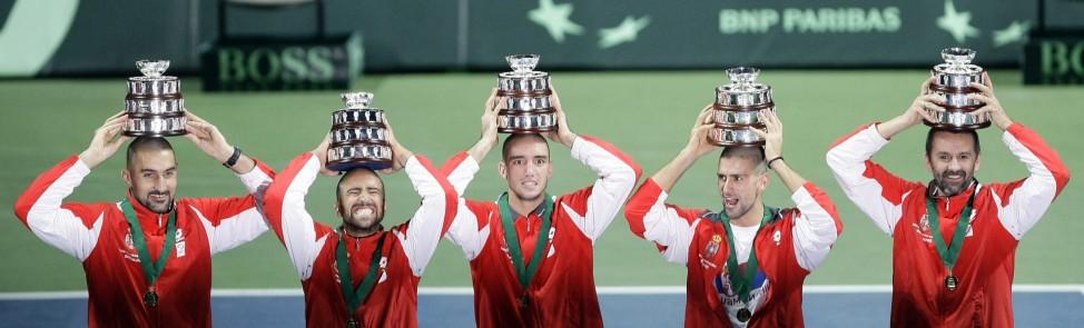 Serbia's Davis Cup team members pose with the Davis Cup trophys in Belgrade