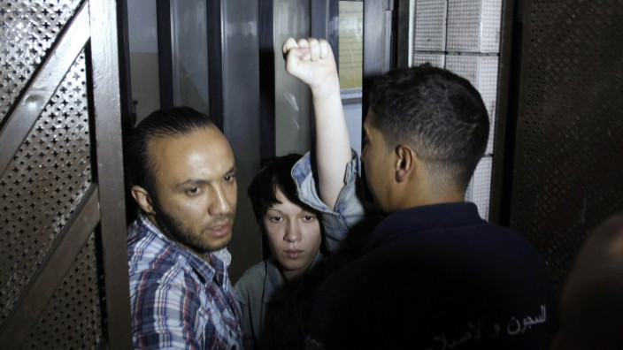 Stern, a member of the women's rights group Femen, gestures after she is released from prison in Tunis