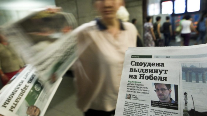 Photograph of former U.S. spy agency contractor Snowden is seen a page of a newspaper in Moscow