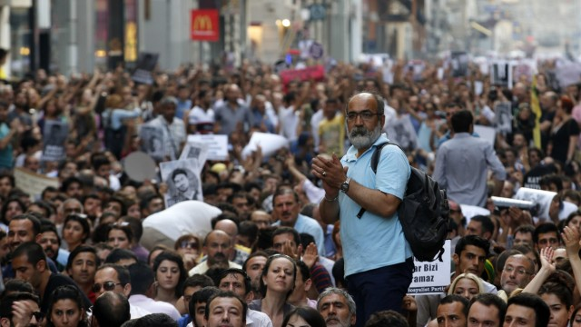 A protester applauds during an anti-government protest at Taksim Square in Istanbul