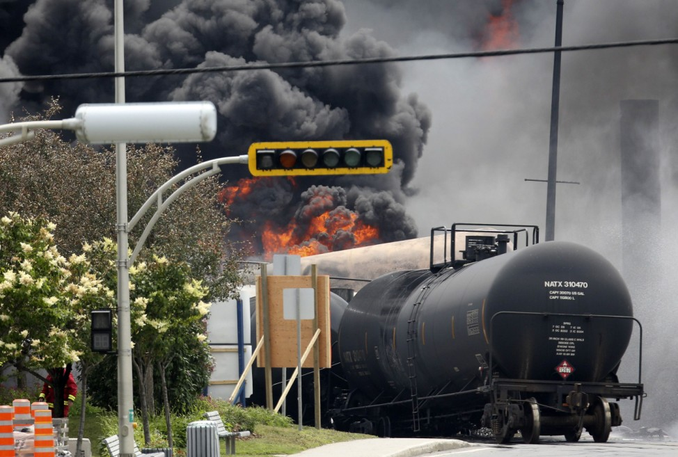 A burning train wagon is seen after an explosion at Lac Megantic