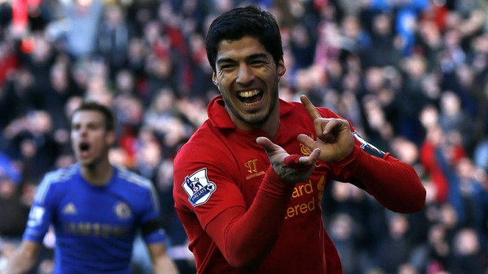 Liverpool's Suarez celebrates his goal against Chelsea during their English Premier League soccer match in Liverpool