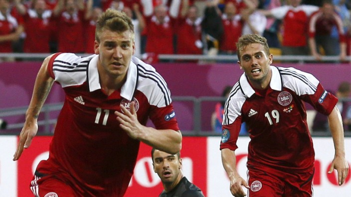 Denmark's Bendtner celebrates with Poulsen after scoring a goal against Portugal's goalkeeper Patricio during their Group B Euro 2012 soccer match at the New Lviv stadium in Lviv