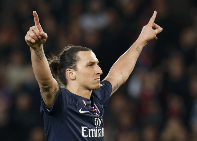 Paris Saint-Germain's Ibrahimovic reacts after scoring a penalty against Nice during their French Ligue 1 soccer match at the Parc des Princes Stadium in Paris