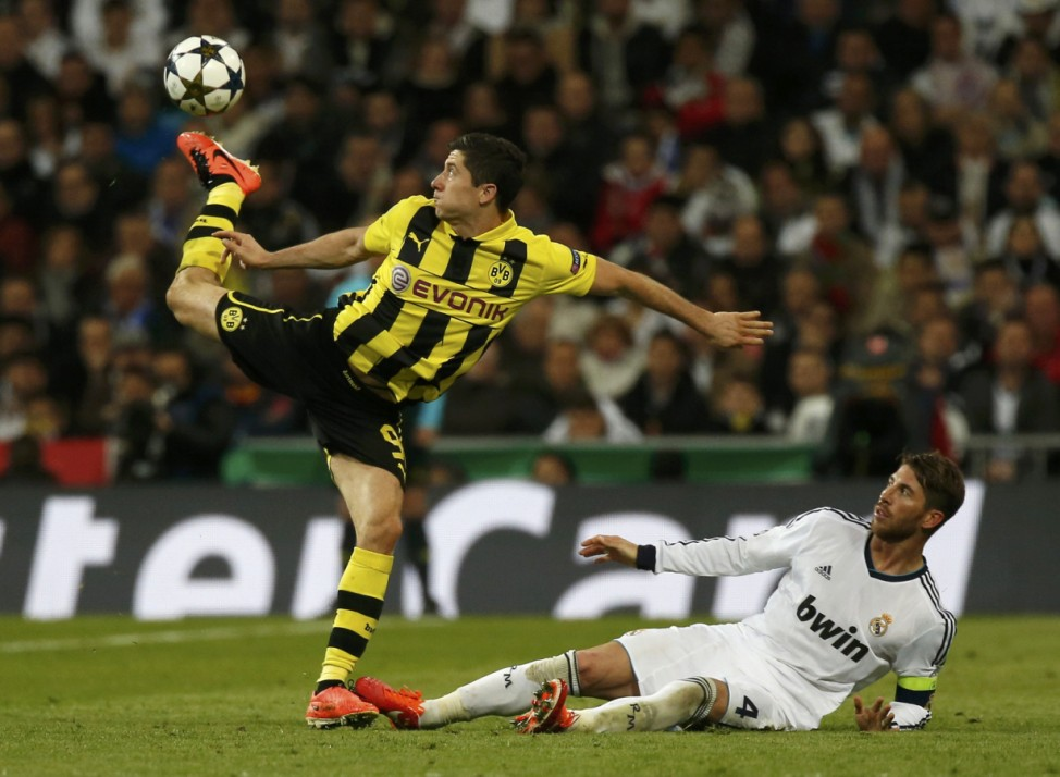 Borussia Dortmund's Robert Lewandowski controls the ball as Real Madrid's Sergio Ramos falls during their Champions League semi-final second leg soccer match in Madrid