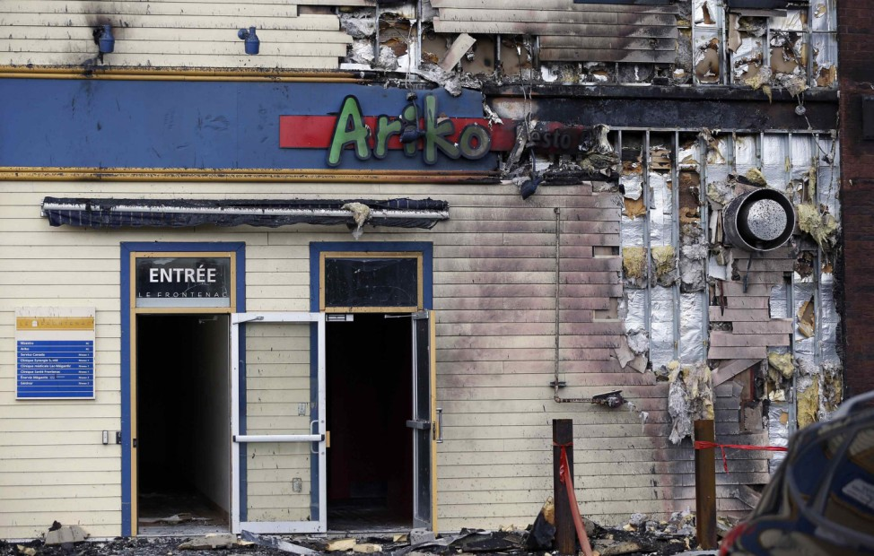 The burnt facade of Ariko restaurant is pictured near the train wreck in Lac Megantic