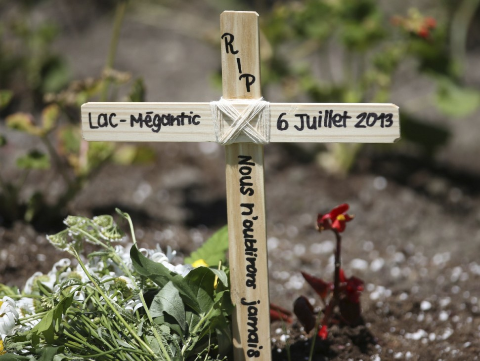 A wooden cross is pictured in front of Sainte-Agnes church in Lac Megantic