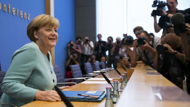 German Chancellor Merkel arrives for a news conference at Bundespressekonferenz in Berlin