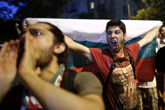Protesters shout anti-government slogans during a demonstration in central Sofia