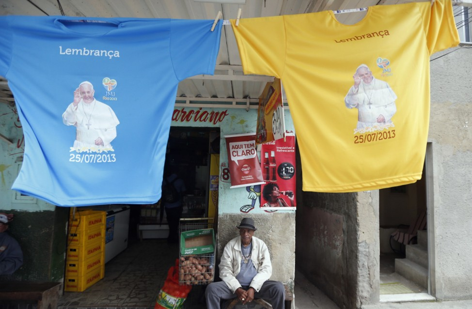 T-shirts with Pope Francis picture are displayed outside shop in Manguinhos slums complex where Pope Francis is expected to visit in Rio de Janeiro