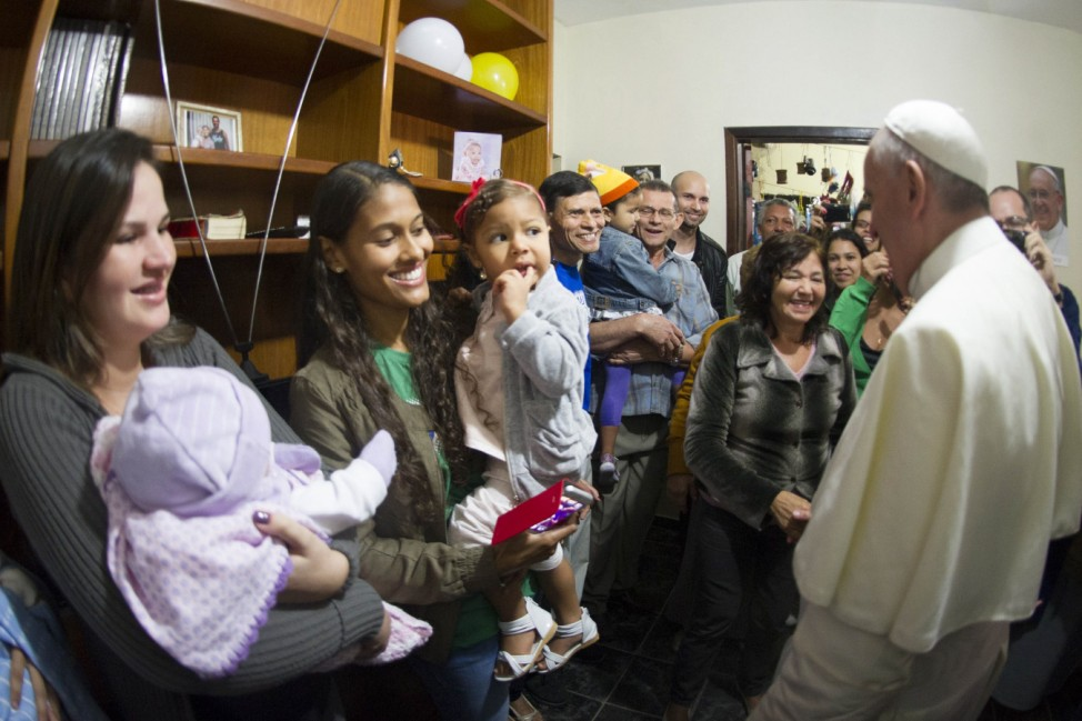Handout shows Pope Francis speaking with residents of the Varginha slum during a visit in Rio de Janeiro