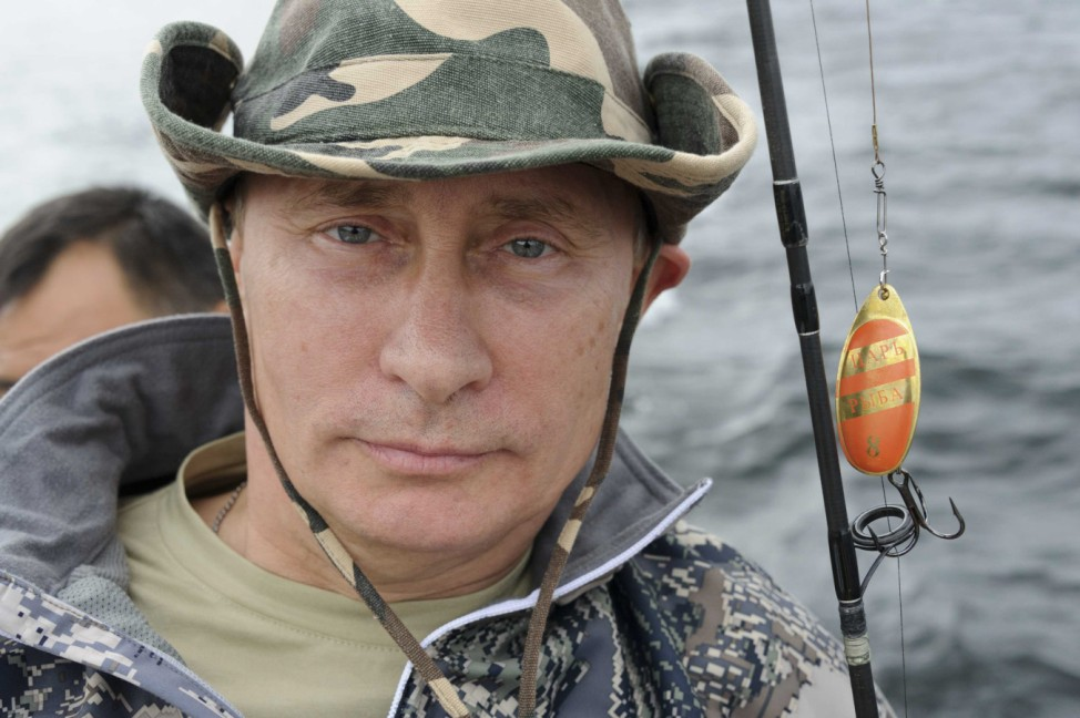 Russia's President Putin poses for a picture as he fishes in the Krasnoyarsk territory in the Siberian Federal District