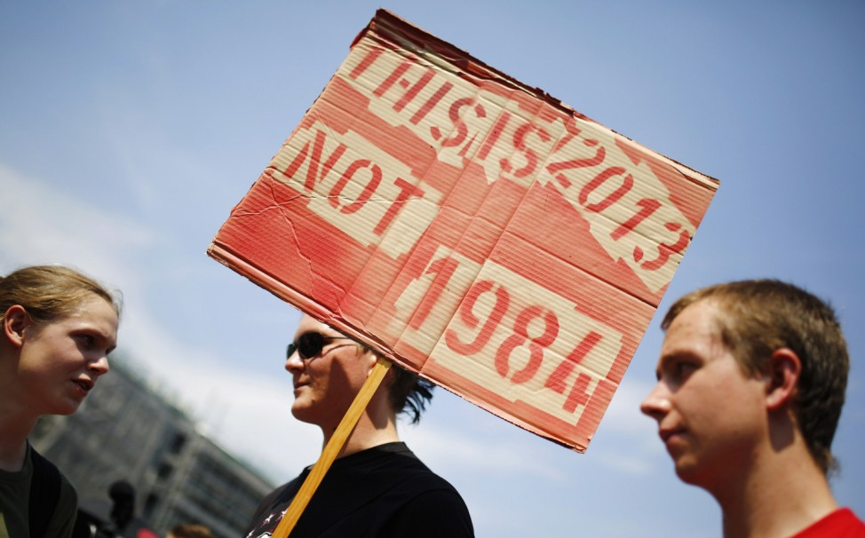 A protester holds a placard during demonstration against NSA and in support of whistleblower Snowden in Frankfurt