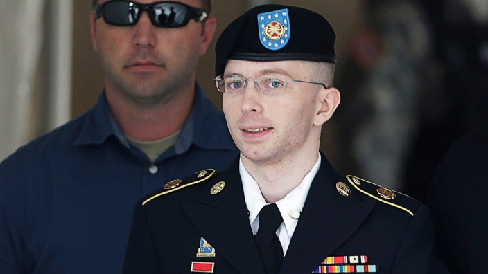 U.S. Army Private First Class Manning departs the courthouse at Fort Meade, Maryland