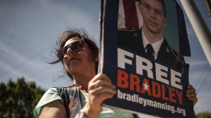 A supporter of US Army Private First Class Manning protests outside the main gate before the reading of the verdict in Manning's military trial at Fort Meade, Maryland