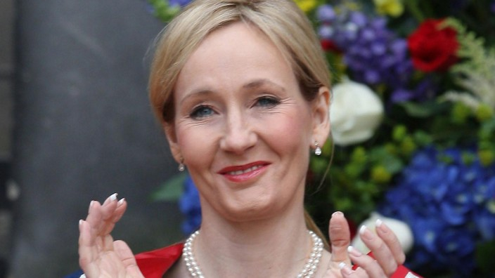 A picture taken on September 26, 2011 shows Harry Potter author J.K. Rowling applauding after receiving a Benefactor's Award at an open air ceremony at the University of Edinburgh.