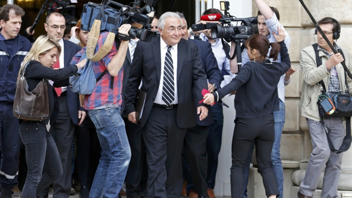 File picture shows former IMF chief Strauss-Kahn surrounded by journalists as he leaves after a French Senate commission inquiry on the role of banks in tax evasion in Paris