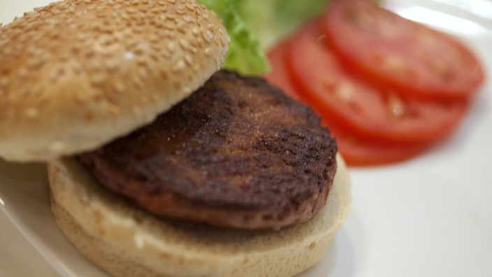 The world's first lab-grown beef burger is seen after it was cooked at a launch event in west London