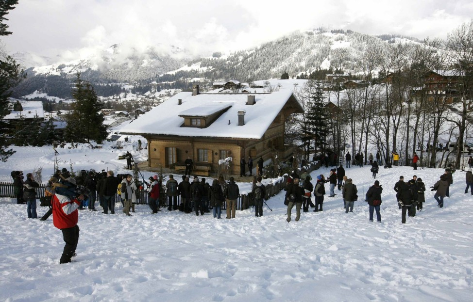 Members of the media stand in front of the chalet 'Milky Way' in the Swiss mountain resort of Gstaad